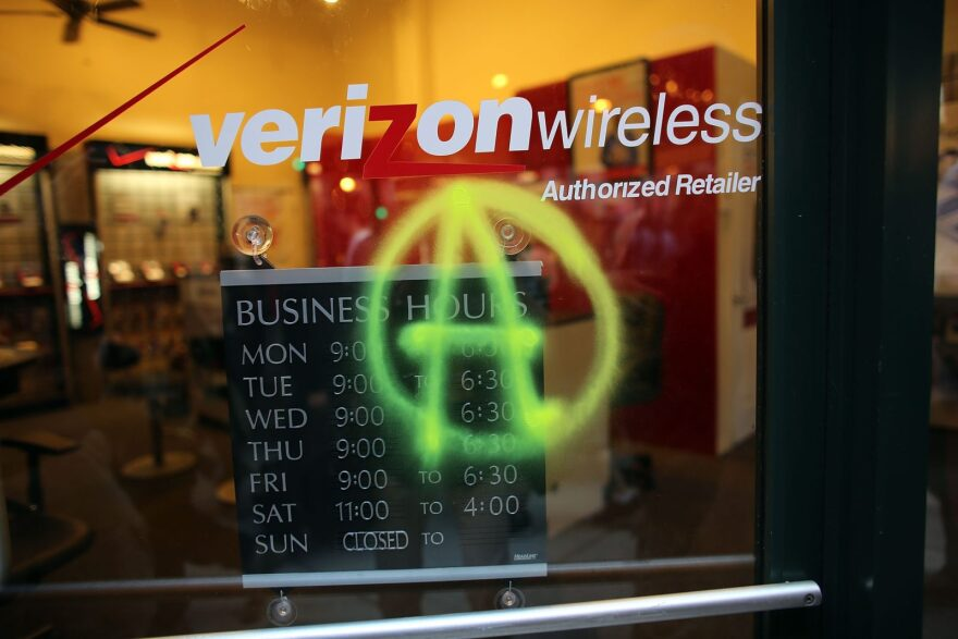 An anarchy symbol is viewed after it was spray painted on a window during a demonstration by Occupy Wall Street and other groups in downtown Chicago on the eve of the NATO summit in Chicago, Illinois.