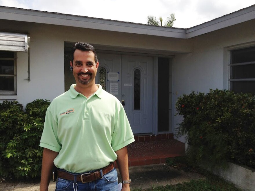 Marc Joseph, a real estate agent, checks on homes that have been foreclosed on.