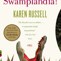 """""""Swamplandia!"""" book cover. It includes an alligator coming out of the grass vertically with its jaws open."""