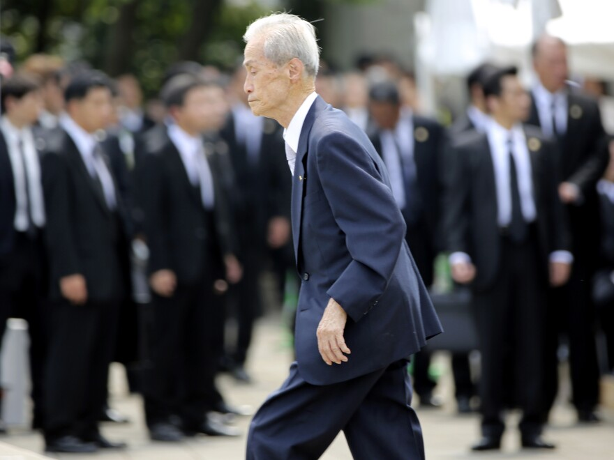 Sumiteru Taniguchi, 86, a survivor of the 1945 atomic bombing of Nagasaki, walks up to deliver his speech at the 70th anniversary of the atomic bombing in Nagasaki, southern Japan, on Sunday.