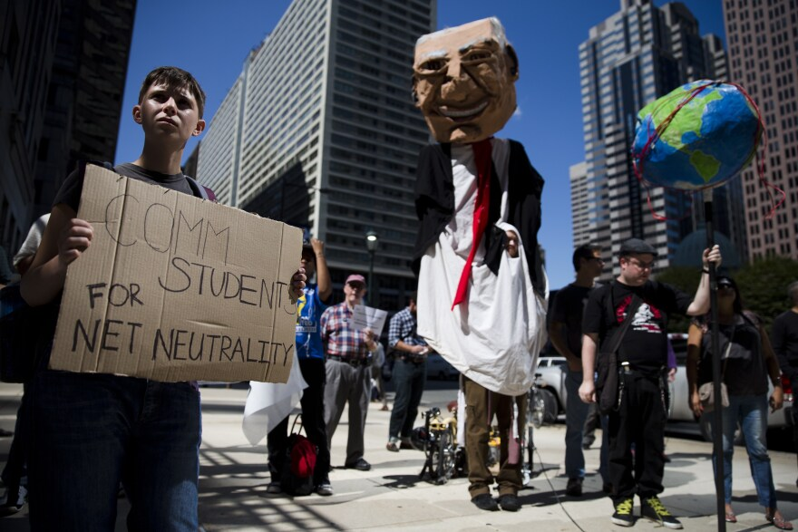 Protesters demonstrate in favor of net neutrality across the street from the Comcast Center in Philadelphia.