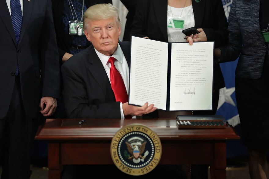 President Trump signs the first travel ban. The second ban has been stayed, for now, but some say it's still affecting American higher education.