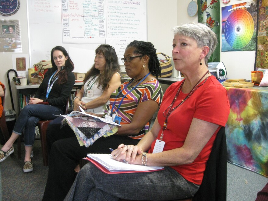 Barbara Rhode (far right) facilitates a daily check-in with the women of Red Tent.