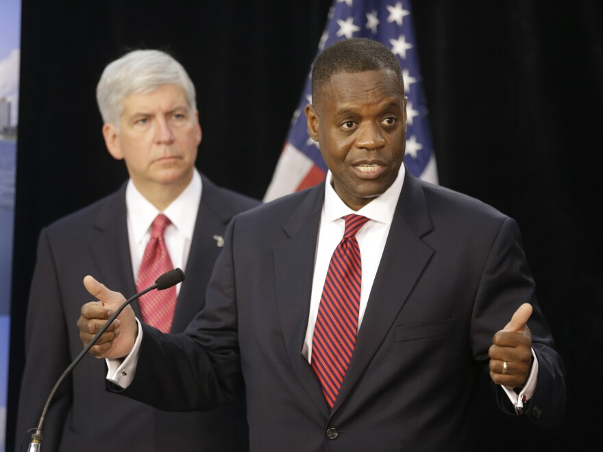 State-appointed emergency manager Kevyn Orr (right) and Michigan Gov. Rick Snyder, at a Friday news conference in Detroit.