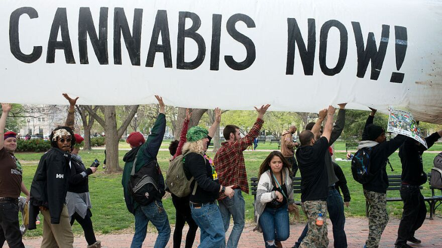Hundreds of advocates for marijuana legalization rally and smoke pot outside the White House in Washington, D.C. on April 02, 2016.