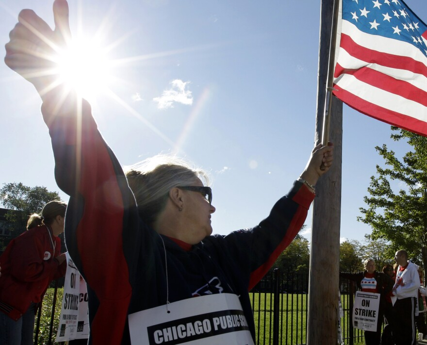 Teacher Patty Westcott pickets outside Clissold Elementary School in Chicago on Tuesday.