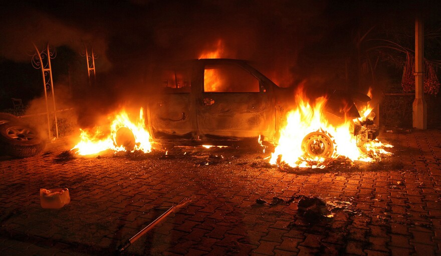 """A vehicle inside the U.S. Consulate compound in Benghazi is engulfed in flames after an attack on Sept. 11, 2012. """"There is no evidence whatsoever that al-Qaida or any group linked to al-Qaida played a role in organizing or leading the attack,"""" says <em>New York Times</em> correspondent David Kirkpatrick."""