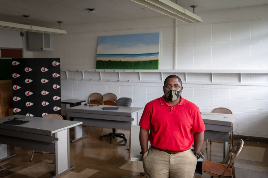 Business teacher Marc Reid spaced out tables in the classroom he's teaching in this summer. He said it can be hard to hear his students when they're spread out and talking through masks.