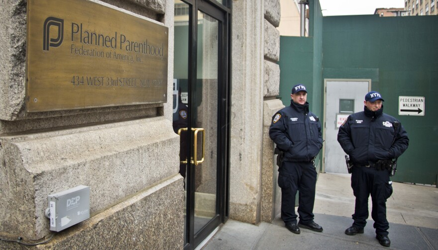 NYPD anti-terrorist officers guard the entrance of a Planned Parenthood office in New York last month.