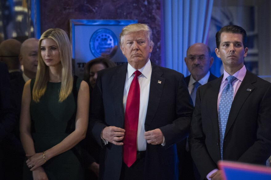 President Trump attends a January press conference at Trump Tower with children Ivanka and Donald Jr., who is the latest member of the Trump team to hire a lawyer.
