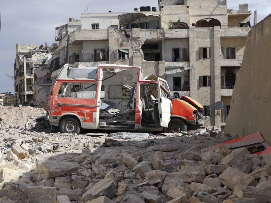 A destroyed ambulance is seen outside the Syrian Civil Defense main center after airstrikes in the rebel-held part of eastern Aleppo, Syria. Prospects of a diplomatic resolution diminished as the U.S. State Department announced it is suspending cease-fire talks with Syrian ally Russia.