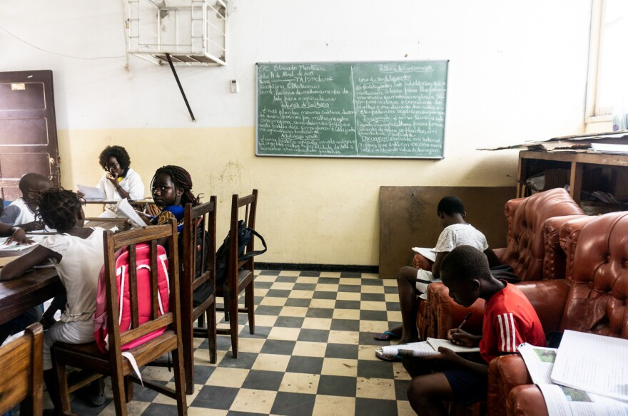 Two groups of seventh graders share the former staff room at the Eduardo Mondlane school.