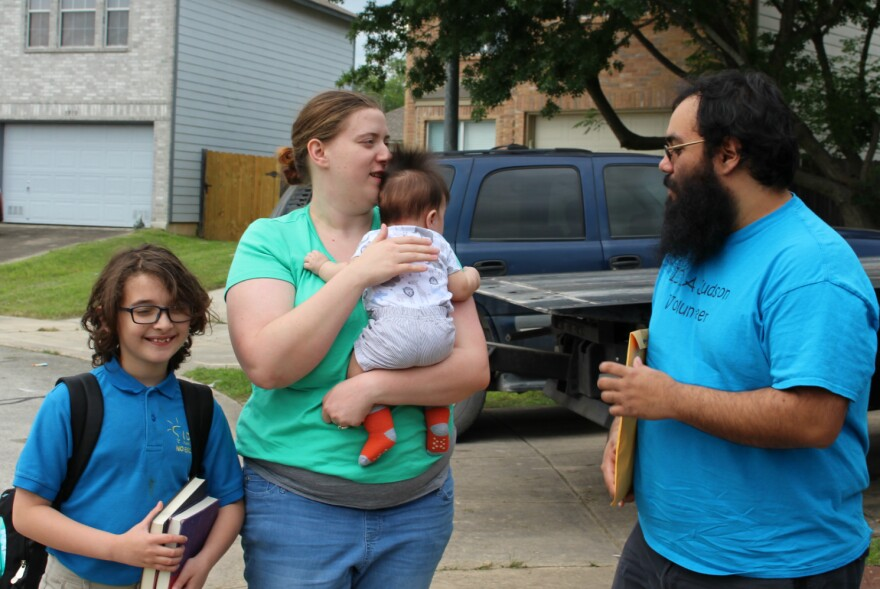 The Cantu family unload from the car after a commute from IDEA Judson on May 13, 2019. Lucas Cantu, 9, brought two Harry Potter books to school that day to read between standardized tests.
