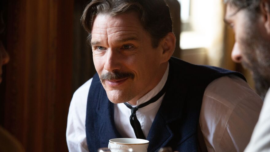 Ethan Hawke plays Serbian American inventor Nikola Tesla in the playful new biopic, <em>Tesla</em>.