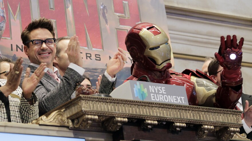 Actor Robert Downey Jr. promotes <em>Iron Man 3 </em>at the New York Stock Exchange on April 30. As far as we know, Musk is <em>not</em> in the Iron Man suit.