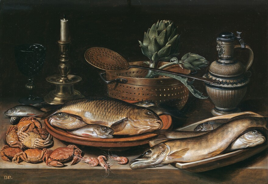<em>Still life with Fish, Candle, Artichokes, Crabs and Shrimp </em>was created by Clara Peeters in 1611.