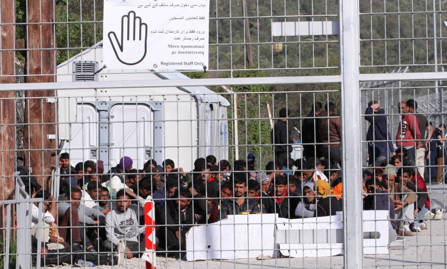 Pakistani refugees go on a hunger strike during a protest against the EU's deportation deal with Turkey at Moria Refugee Camp in Lesbos, Greece, on Wednesday. The pope and the Orthodox Church's ecumenical patriarch may be visiting the island soon.