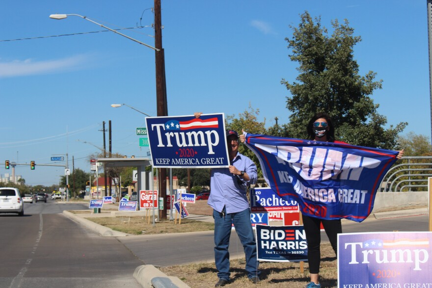 Two Trump supporters rally for the incumbent outside a polling place in Bexar County on Election Day.