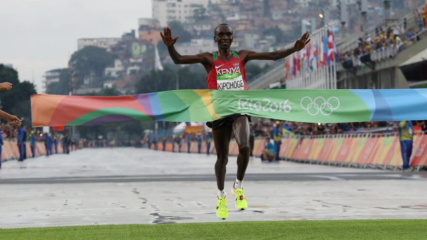 Kenya's Eliud Kipchoge crosses the finish line to win the men's marathon in Rio on Sunday. He won by more than a full minute.
