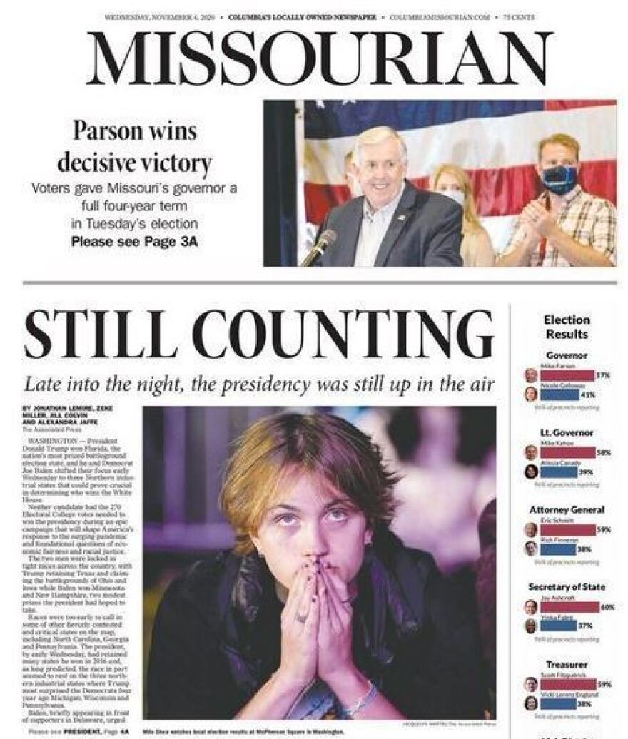"At the Columbia <em>Missourian</em>, the front page reflected a sense of anxiety about the too-close-to-call result. The lead image was of a person in MacPherson Square in Washington, D.C., fingers tented in anticipation, under the all-caps headline: ""Still Counting."""
