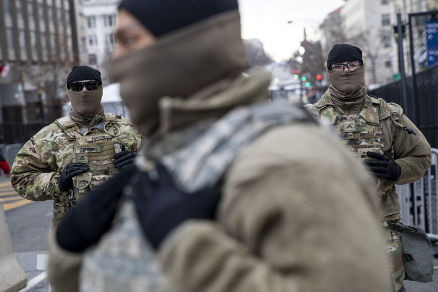Members of the National Guard stand at a downtown checkpoint in Washington, D.C.