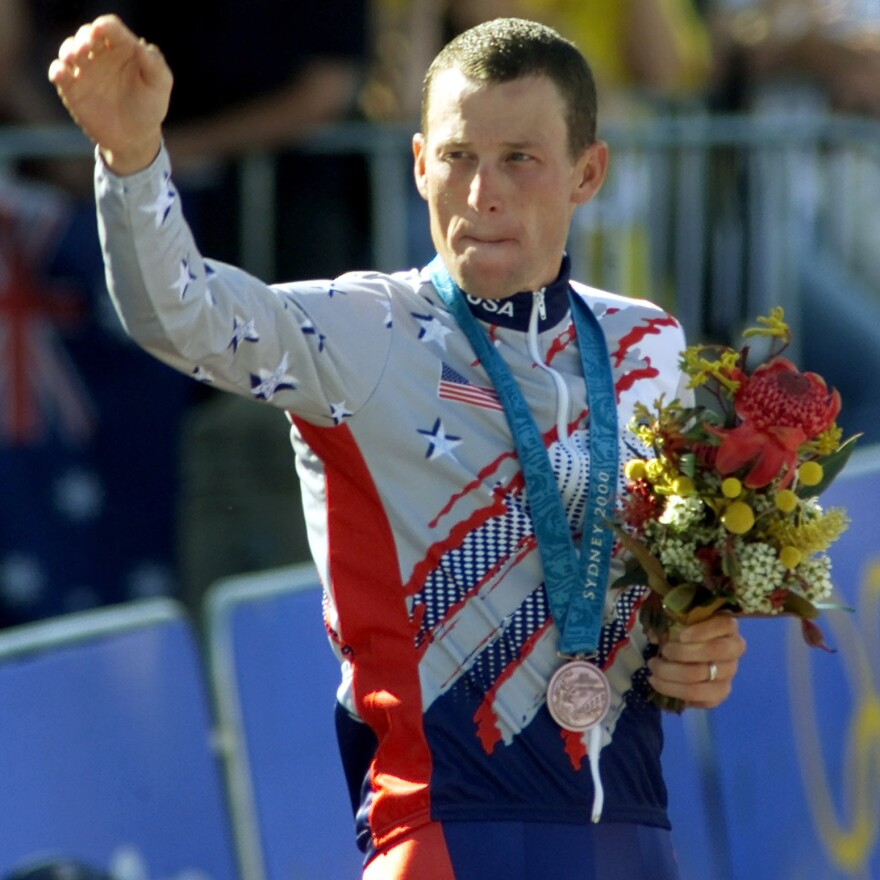 Lance Armstrong at the 2000 Sydney Olympic Games, celebrating his bronze medal performance.