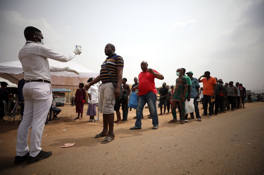 People get their temperatures taken at the border between Abuja and the Nasarawa State, Nigeria, on March 30. African countries are working to prepare for the rise in cases of COVID-19 as the coronavirus spreads on the continent.