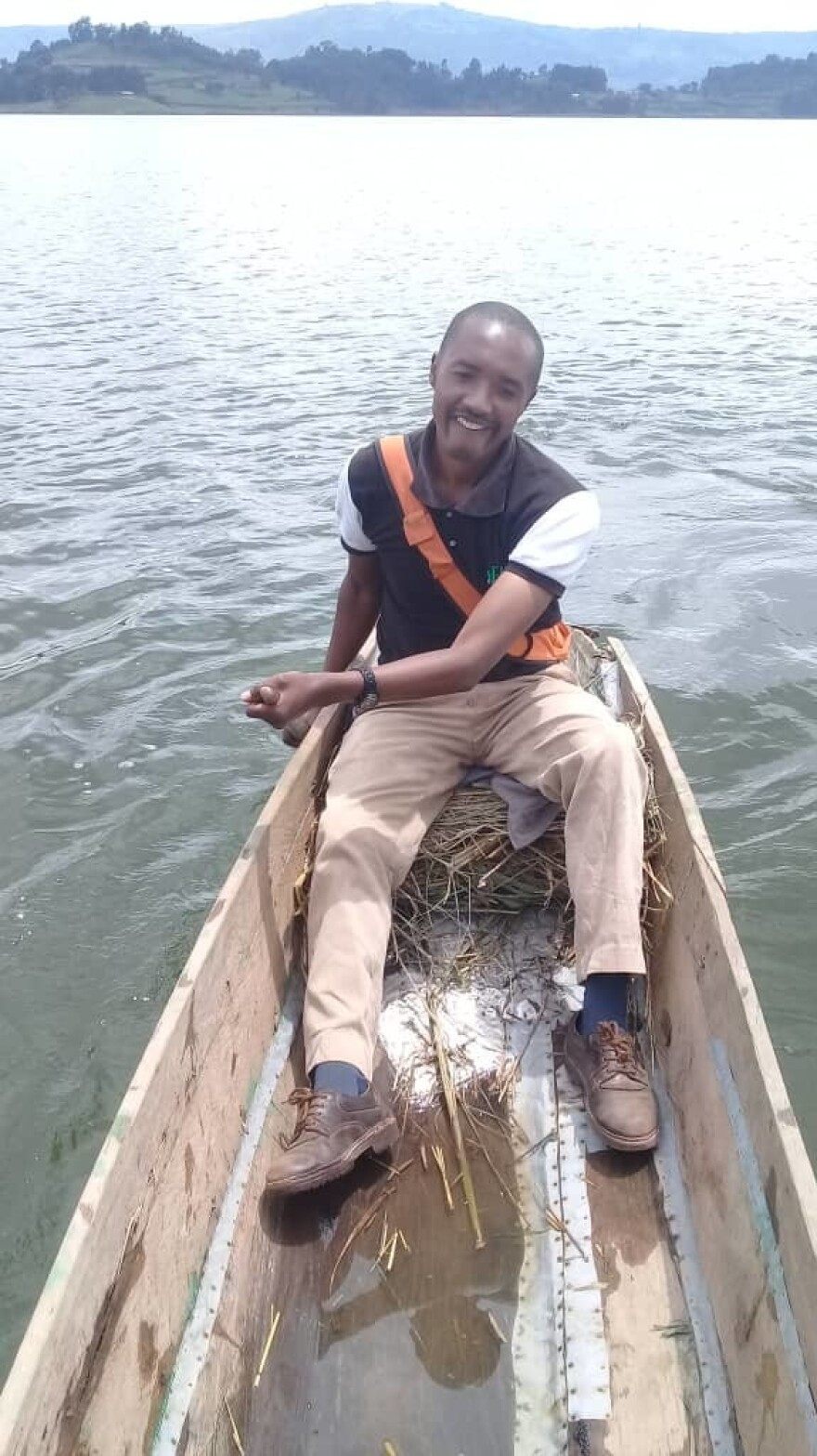 Edward Arineitwe, a nurse, rents a canoe to paddle himself to the health facility where he works — it's located on an island.