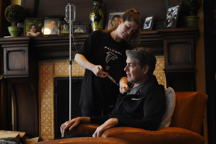 Tim's daughter-in-law, Jessica Green, gives him an infusion of Radicava. Last year the FDA approved the new drug, which has been shown to slow the progress of what's currently a fatal disease.