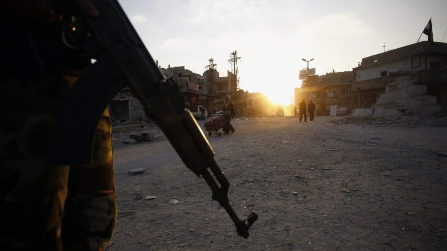 In the Syrian town of Hejeira, a fighter from a Shiite militia patrolled last week.