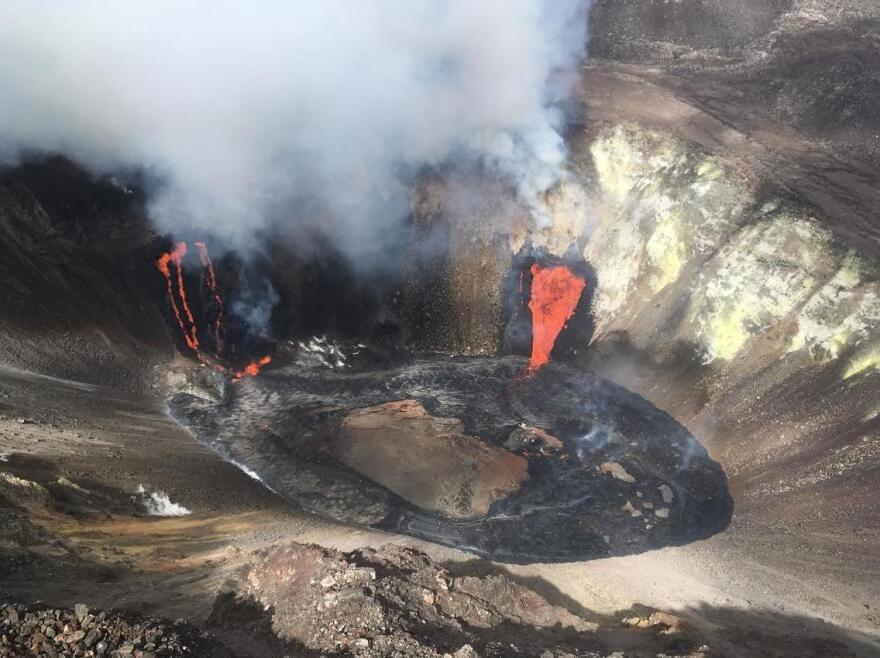 An aerial view of the Kilauea summit shows the eruption from a Hawaiian Volcano Observatory overflight at approximately 11:20 a.m. on Dec. 21. The two active fissure locations continue to feed lava into the growing lava lake.