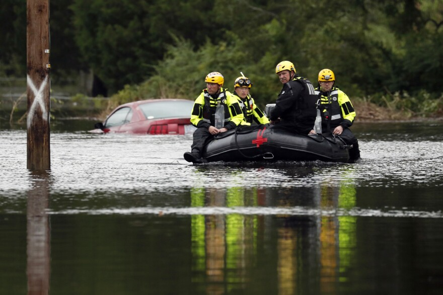 Members of a swift water rescue team check a flooded street caused by the tropical storm Florence in New Bern, N.C., on Saturday. Rescuers have pulled more than 200 people from their homes to safer ground as of Saturday morning in New Bern.