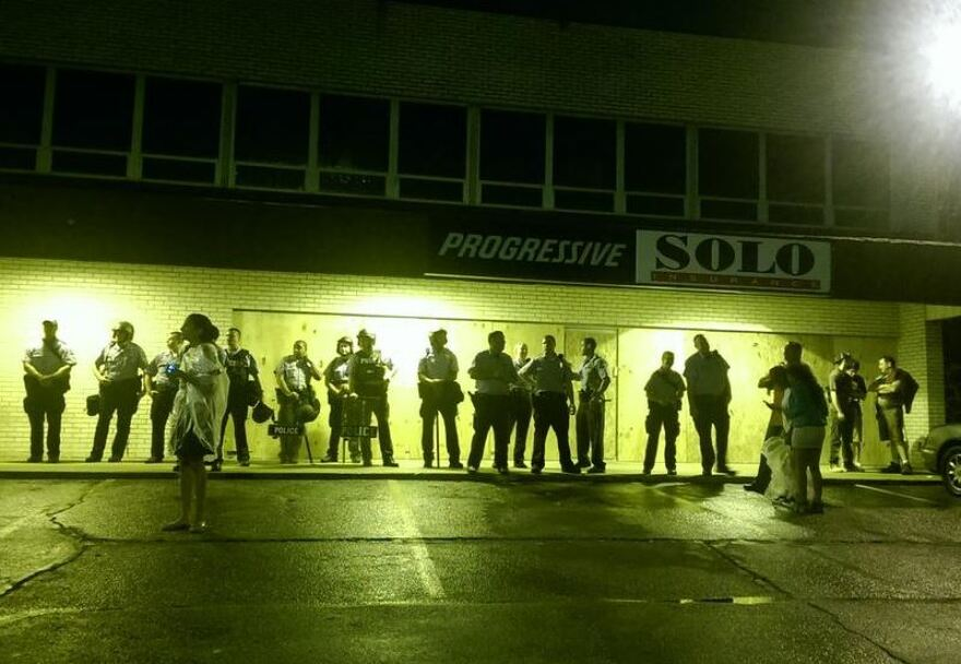 Police stood outside businesses on West Florissant as the night grew late. Most protestors left by 11:30 p.m.