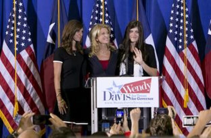 Wendy Davis with her daughters, Amber (left), and Dru, when she announced she was running for governor.