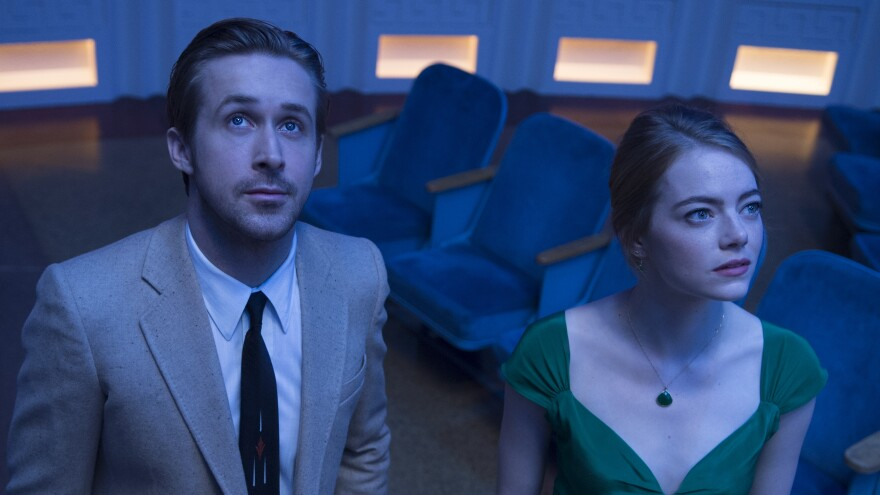 Ryan Gosling and Emma Stone are aspiring artists in the movie musical <em>La La Land.</em> The film has been nominated for seven Golden Globe awards.