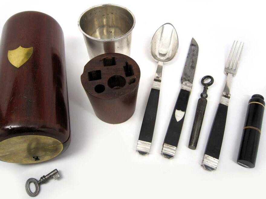 """<strong>Dig In:</strong> This nonregulation Civil War mess kit features a fork, knife, spoon, corkscrew, salt and pepper shaker, and cup enclosed in a mahogany carrying case. The typical kit was much less fancy and <a href=""""http://www.nwaonline.com/photos/2011/mar/06/90030/"""">looked more like this</a>."""