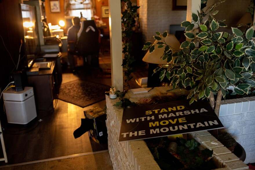 Signs and posters calling for the removal of Shingle Mountain are scattered throughout Marsha Jackson's home.