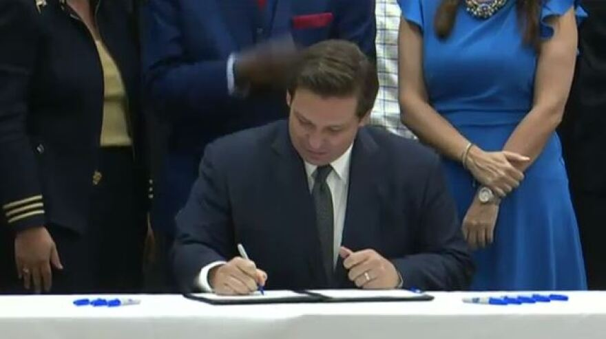 Gov. Ron DeSantis signing the teacher pay bill