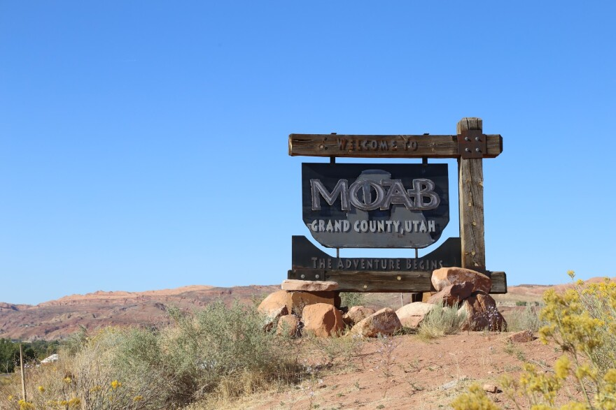 Photo of a road sign that welcomes visitors to moab