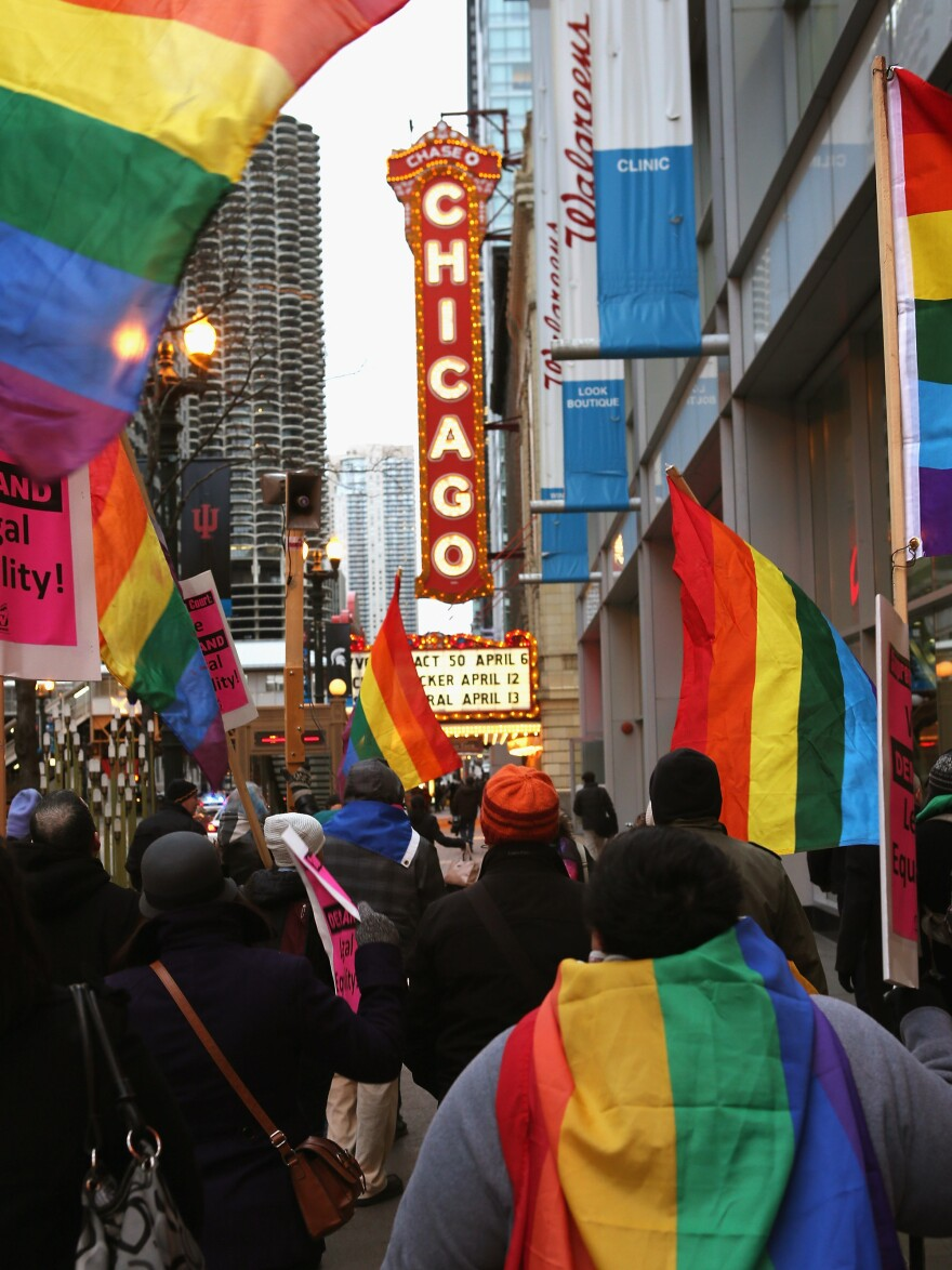 Activists rally in support of gay marriage on March 25 in Chicago. The Illinois Senate has approved legislation that will legalize same-sex marriage, but it has stalled in the state House.