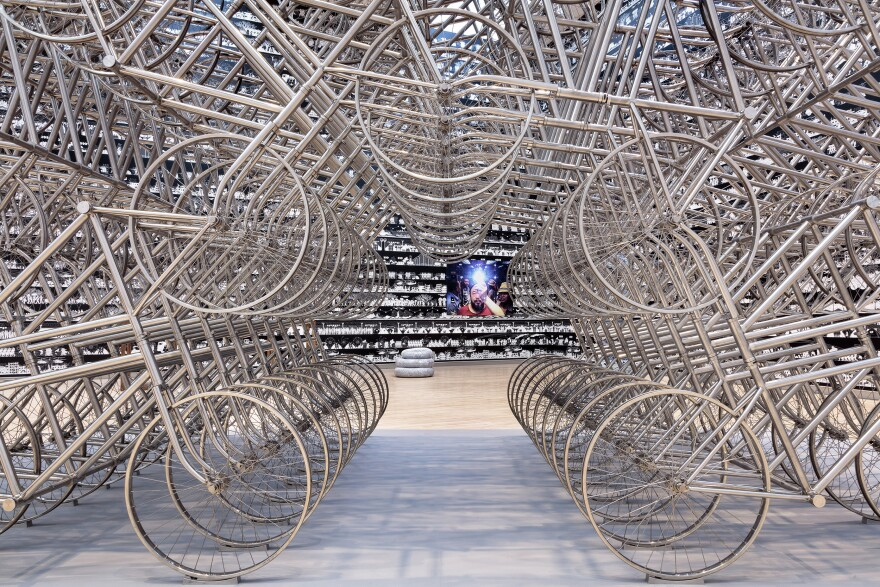 "Ai Weiwei's iconic self-portrait ""Illumination"" is seen at the far wall. ""Forever Bicycle"" is in the foreground. [11/8/19]"