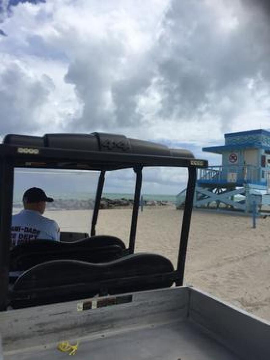 """Ocean Rescue Lieutenant Matthew Sparling parked by Lifeguard tower 1, or as they call it, """"ground zero"""" for Haulover's Red Tide."""