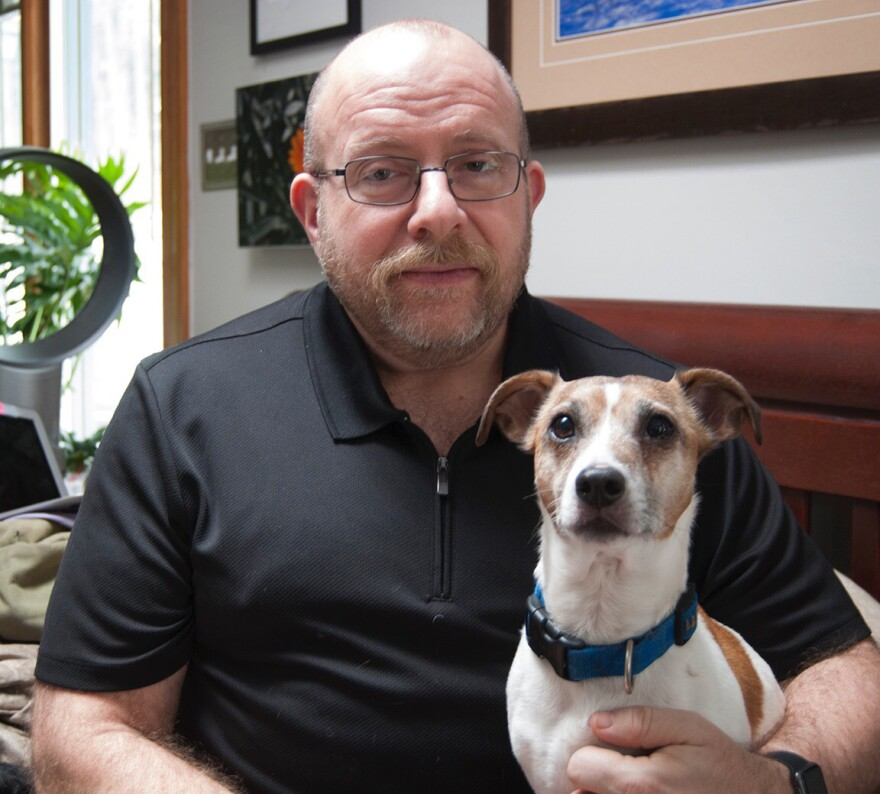 Phil Gutis with his dog, Abe, who died last year. Gutis, who has Alzheimer's, hoped an experimental drug could help preserve his memories.