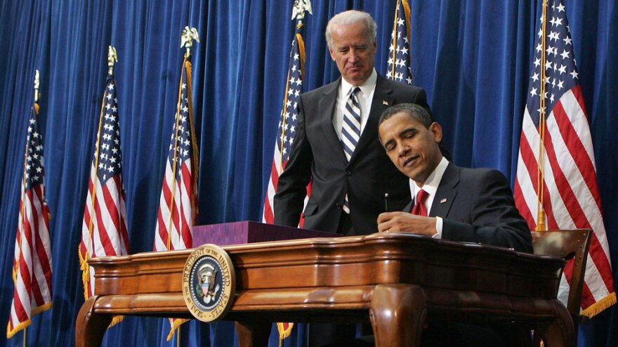 President Obama signs the economic stimulus bill in February 2009, as Vice President Biden looks on. Experts disagree over the impact of the administration's economic policies on the recession.