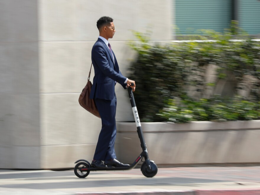Electric scooters for rent are popping up in San Diego and other cities. Investors see a key role for new way of getting from here to there. But many people find them downright annoying.