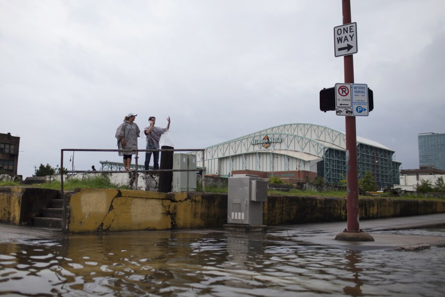 """Margy (left) and Rich Reynard live in the downtown Houston area. """"Where we live, the streets are fine,"""" says Rich. """"If we get 15 more inches of rain, I don't know that it can stay that way."""""""