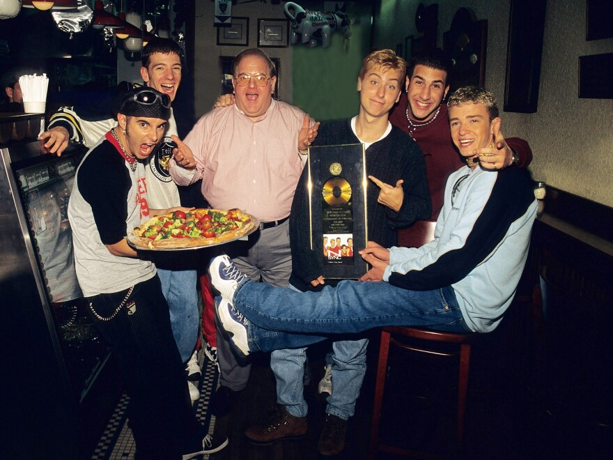 Lou Pearlman (center) poses with *NSYNC Chris Kirkpatrick, JC Chasez, Lance Bass, Joey Fatone and Justin Timberlake at N.Y.P.D. pizzeria in Miami, circa 1996.