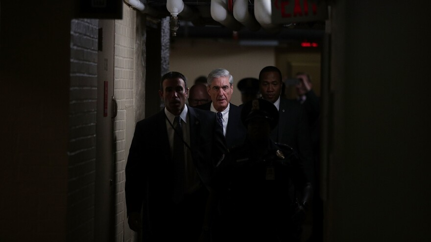 Justice Department special counsel Robert Mueller (center) leaves after a closed meeting with members of the Senate Judiciary Committee on June 21, 2017, at the Capitol in Washington, D.C.