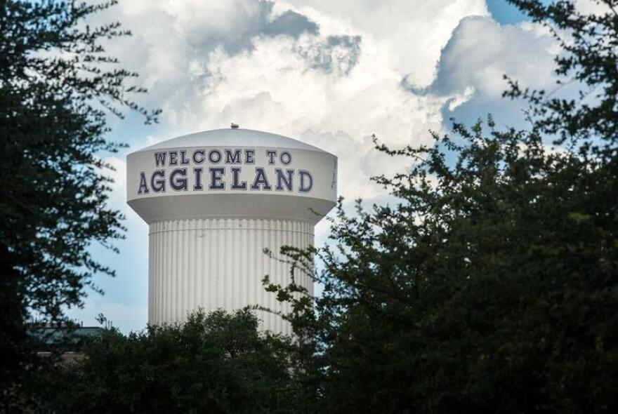 A water tower says Welcome to Aggieland.