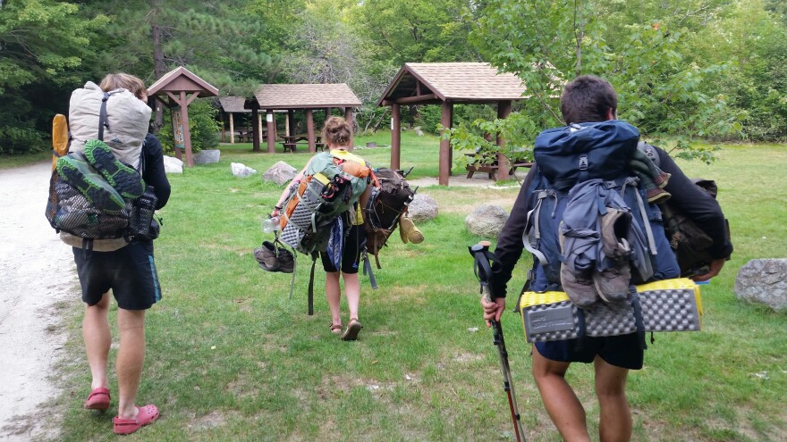 Matthew Fioramonti, Kacy Hale and Alexander Scherlitzky at Katahdin Stream Campground after completing the entire Appalachian Trail.